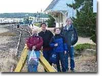 End of the line at Montauk, looking west.  Group poses at bumper post.  Trains now use high-level platform west of the station building.