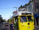 "In the Castro District, we missed this ""F-Market & Wharves"" streetcar in yellow Cincinnati livery due to the rest room break."